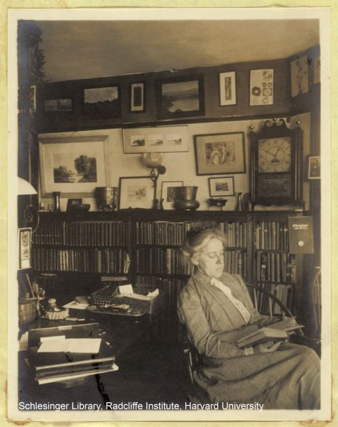Portrait of Alice Rich Northrop sitting in her office, reading