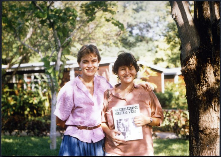 Two images of women holding copies of Nuestros Cuerpos, Nuestras Vidas they delivered and donated to organizations in Nicaragua on behalf of BWHBC