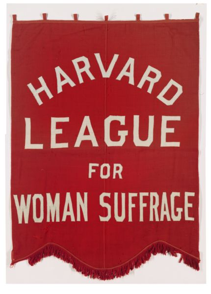 "Red banner reading ""Harvard League for Woman Suffrage"" in white letters."