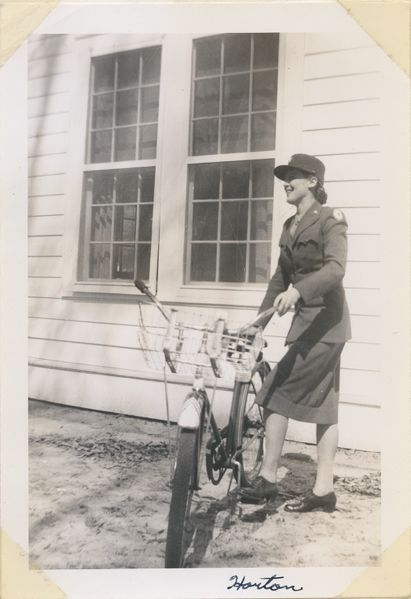 WAAC member with bicycle