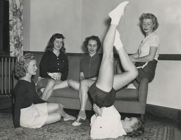 Boston YWCA members demonstrating posture and stretching exercises
