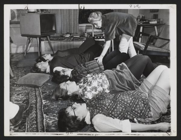 Three images of Elisabeth Bing and her students during a Lamaze class