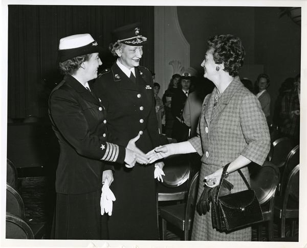 Captain Winifred R. Quick, USN, and Colonel Margaret Henderson, USMC, chat with Mrs. Mortimer Fleishhacker, jr., DACOWITS member, after general meeting of the Junior League of San Francisco, Mark Hopkins Hotel, 13 March 1959.