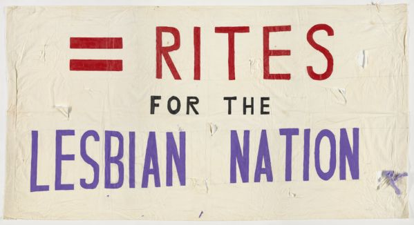 "Lesbian rights banner. White with hand-painted red, black, and purple text, ""= Rights for the Lesbian Nation."""