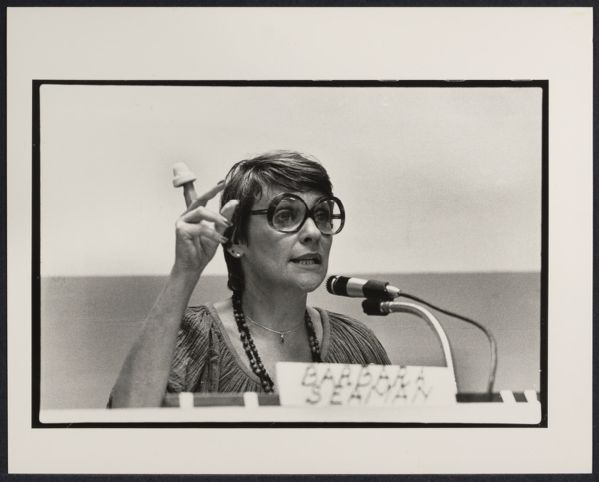 Barbara Seaman holding vaginal cap at Pre-1980 Women's March press conference