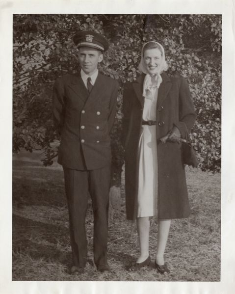 Portrait of Flo and Ted Bouna[?] outdoors; he is in navy uniform