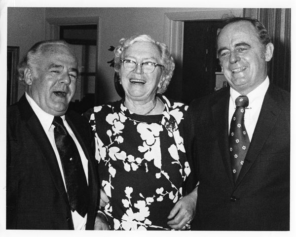 Dr. Louise Holborn (center) stands with Deputy Consul General of the the Federal Republic of Germany, Dr. Wolf Mueller (left), and an unidentified man; Dr. Mueller awarded Dr. Holborn the Order of Merit from the Federal Republic of Germany