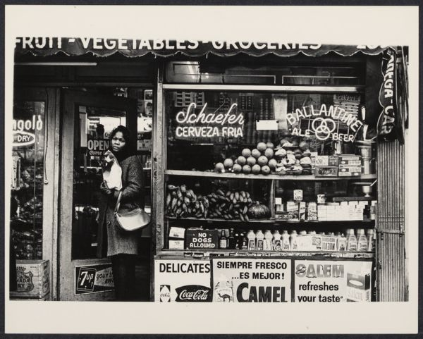 Woman at a Spanish grocery store in New York City, ca.1970