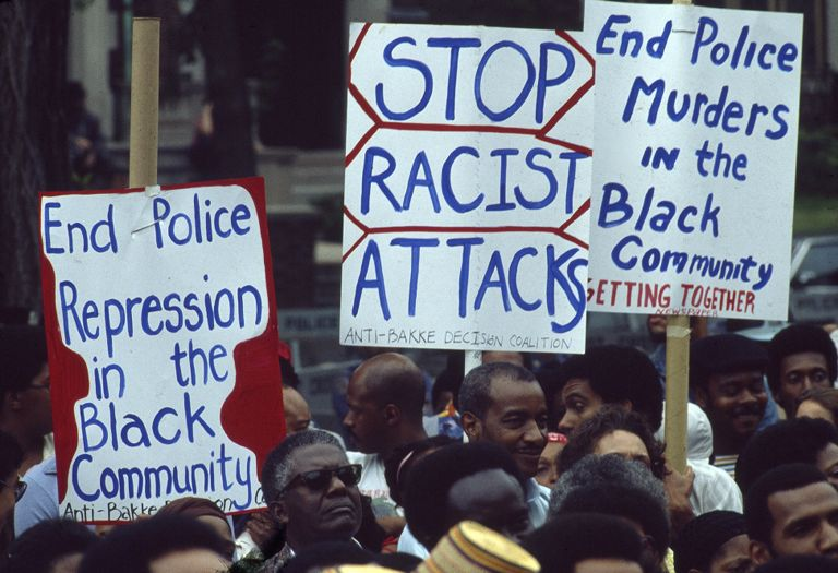 Three signs at the July 16, 1978 Crown Heights demonstration for Black Civil Rights; [Text on signs: Stop racist attacks. End Police repression in the Black community. End Police murders in the Black community.]