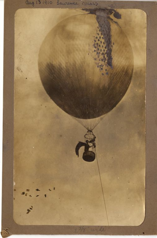 Margaret Foley in hot air balloon distributing suffrage pamphlets, 1910.