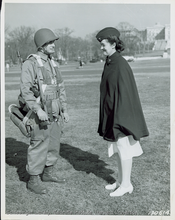 Portrait of Josephine Etz in uniform speaking outdoors with a soldier
