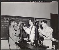 [Hugo Smith, Sam Morrison, Joseph E. Hawkins, and Yiwen Tang working with Haldane apparatus in physiology lab], Digital Object