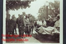 W.H. Craig and other wounded and disabled men being greeted by military officers, possibly of the Belgian army.
