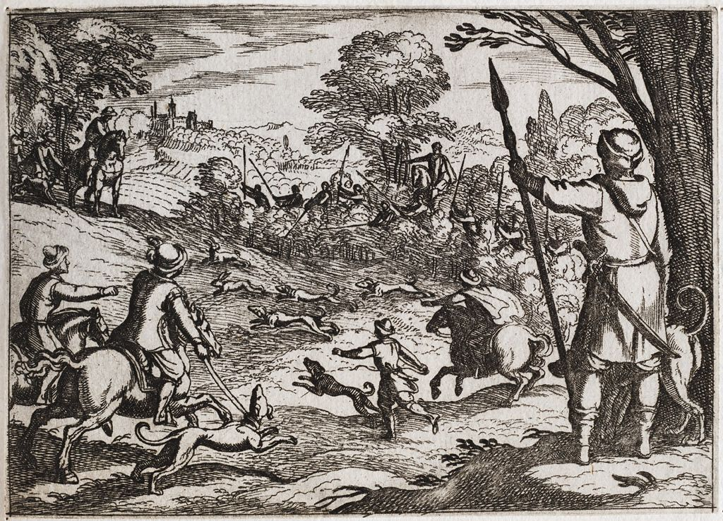 A Rabbit Hunt With Men Chasing Rabbits From The Bush