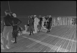 [Group Of People On Dock]