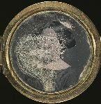Woman, portrait set in a locket
