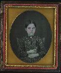 Girl holding daguerreotype