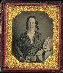 Woman holding an open daguerreotype