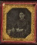 Girl holding a daguerreotype