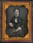 Woman holding daguerreotype case