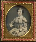 Woman sitting and holding a daguerreotype