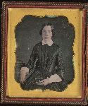 Woman holding daguerreotype