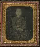 Girl holding a daguerreotype