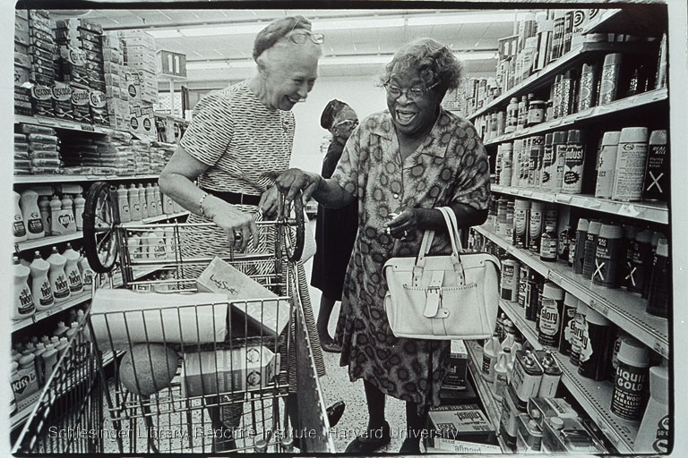 Esther Peterson (left) shopping with an unidentified woman in a supermarket, ca.1970-1977.