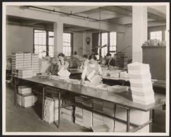 Women inspecting pages
