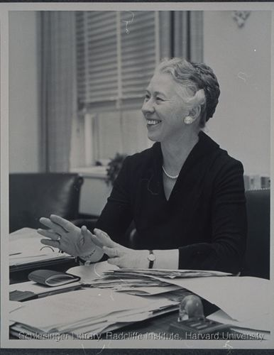 Esther Peterson working at her desk at the U.S. Department of Labor