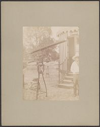 [View of telescope with man to the side, photograph]