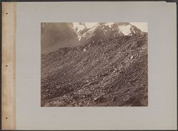 [View of mountainside with rocks in foreground]