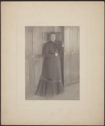 [Williamina Fleming at Harvard College Observatory plate stacks, ca. 1900]