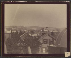 [View of homes in Cambridge from above with telescope in foreground]