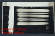 Unidentifiable laboratory experiment results or photographic documentation of an experiment, possibly in progress.  Handwritten notes scratched into negatives for both images.