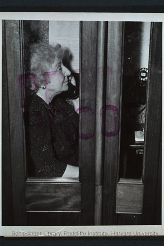 eannette Rankin seated in a House of Representatives's cloakroom telephone booth after casting her vote against a declaration of war on Japan (World War II).