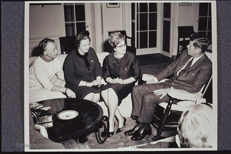 President Kennedy meeting with Esther Peterson, Virginia Allan, and Dr. Minnie C. Miles at the White House.