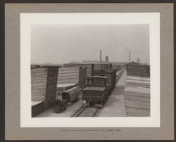 Electric locomotive and tractor for lumber yard