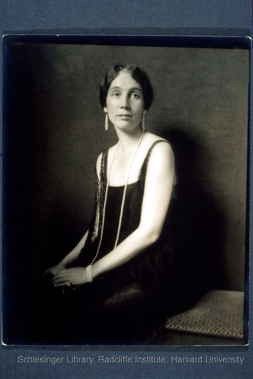Isabelle Pendleton, seated on a bench indoors and dressed in an evening gown