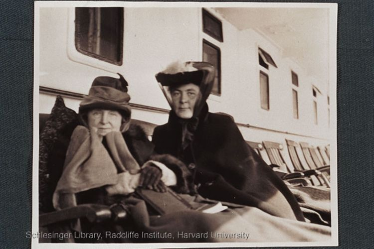 Sarah Shurtleff and Gertrude Hope Shurtleff seated on chairs on the deck of a ship.