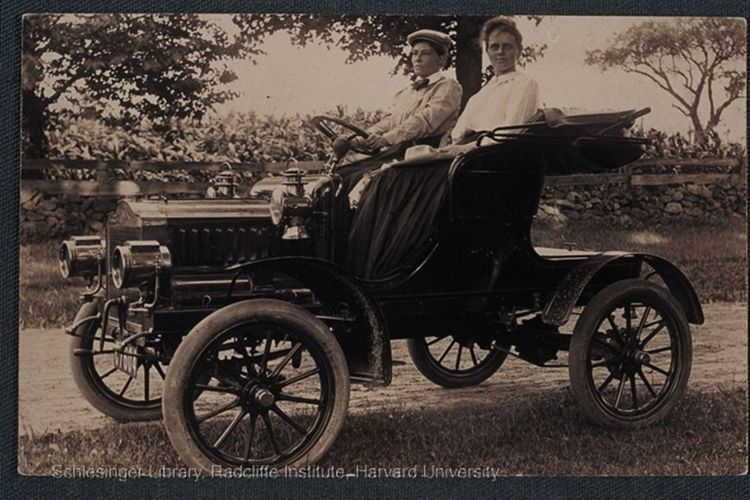 Frances Kellor and Mary Dreier seated in an early automobile resembling the Model T, circa 1905-1920