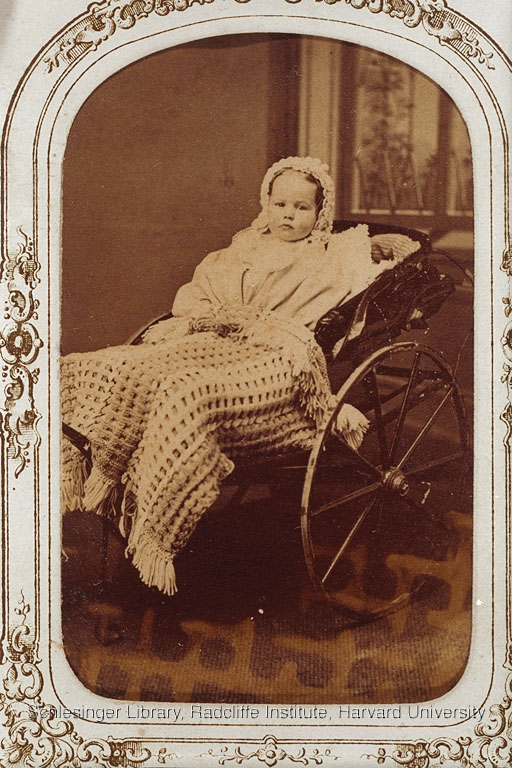 Portrait of an unidentified child in a baby carrriage