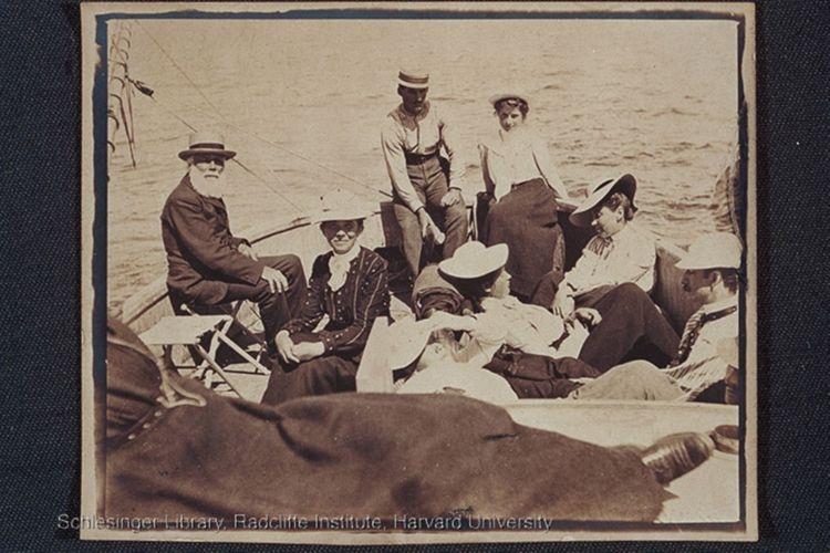 Members of the Blackwell family on a sailboat (either sitting or reclined). George Washington Blackwell, left, is seated left with his wife, Emma Stone Blackwell next to hom. Tom Jones seated far right.