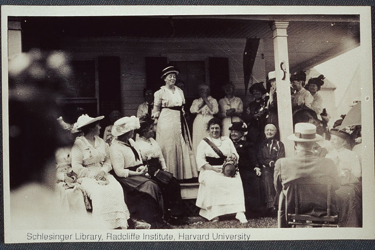 Suffrage meeting taking place on a porch, including Alice Stone Blackwell.