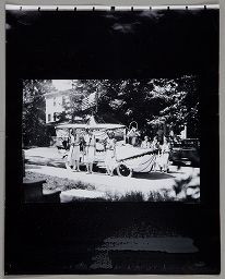 Untitled (Six Young Women Posing With Fourth Of July Float)
