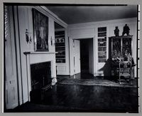 Untitled (View Of Parlor With Parquet Floors, Built In Bookshelves, Paintings And Fireplace)