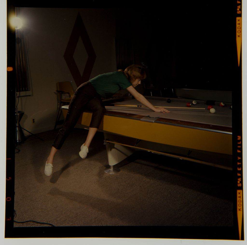 Untitled (Woman Or Child Playing Pool)