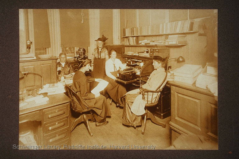 Stantial, Luscomb, Blackmur, Needham, and an unidentified woman at the offices of the Boston Equal Suffrage Association for Good Government.
