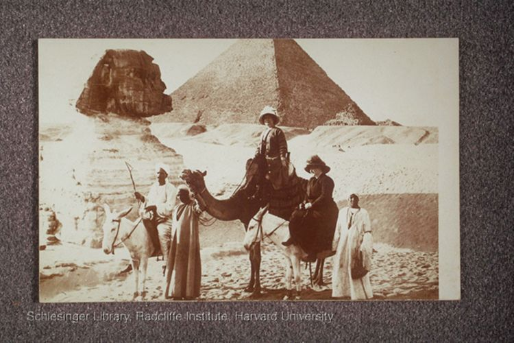 Seton, seated on a camel, with unidentified woman and three Egyptian guides, in front of the Sphinx and a Pyramid in Egypt.