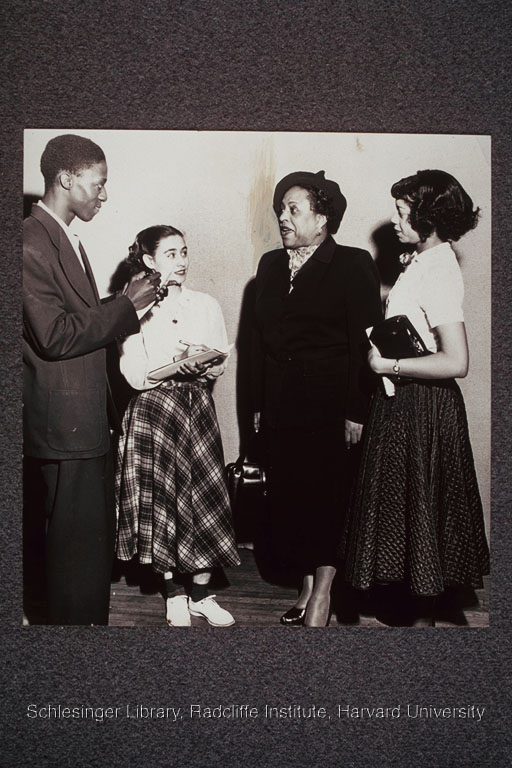 Edith Spurlock Sampson talks to three teenagers.